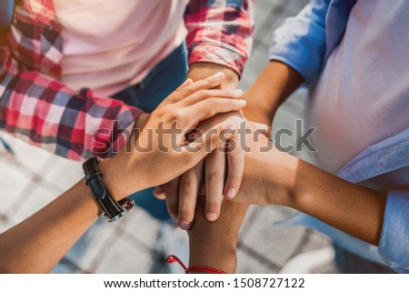 Unity concept. Top view of little children putting their hands together indoors #1508727122