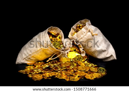 Lots of gold coin in treasure sack at black background #1508771666