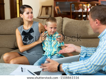 Professional consultant making presentation with laptop for woman with little son at home #1508861516