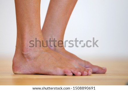 Woman bare feet on the floor. Legs care and skin treatment concept. #1508890691