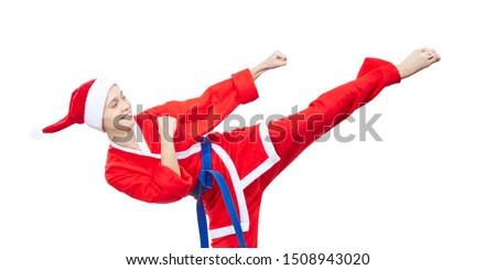 Woman in clothes Santa Claus beats a kick leg #1508943020