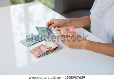 Euro money and Polski Zloty PLN in a womans hands on a white background. Euro in Poland. Euro vs Polski Zloty. Euro vs PLN #1508957639