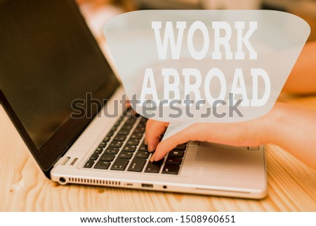 Conceptual hand writing showing Work Abroad. Business photo showcasing Immersed in a foreign work environment Job Overseas Non Local woman with laptop smartphone and office supplies technology. #1508960651