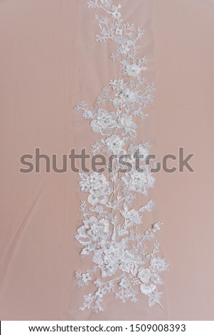 Texture lace fabric. lace on white background studio. thin fabric made of yarn or thread. a background image of ivory-colored lace cloth. White lace on beige background. #1509008393