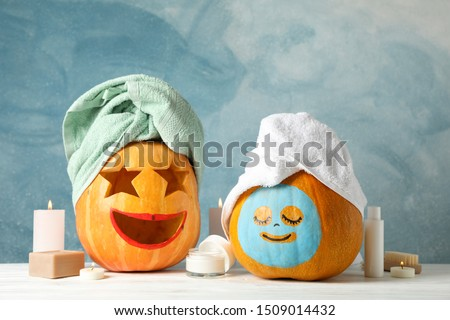 Funny pumpkins and skin care accessories on white background, copy space #1509014432