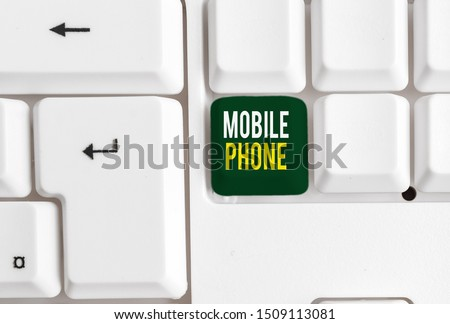 Conceptual hand writing showing Mobile Phone. Business photo showcasing A handheld device used to send receive calls and messages White pc keyboard with note paper above the white background. #1509113081