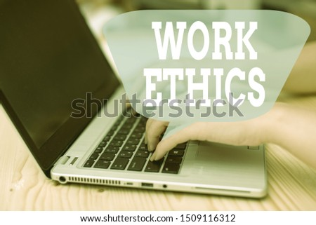 Conceptual hand writing showing Work Ethics. Business photo showcasing A set of values centered on the importance of doing work woman with laptop smartphone and office supplies technology. #1509116312