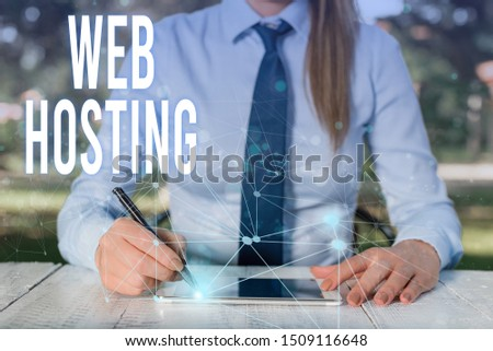 Conceptual hand writing showing Web Hosting. Business photo showcasing The activity of providing storage space and access for websites Female human wear formal work suit presenting smart device. #1509116648