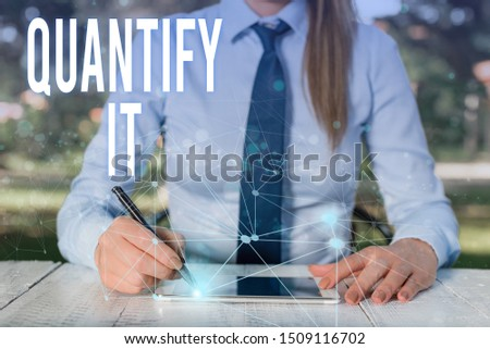 Conceptual hand writing showing Quantify It. Business photo showcasing Measure the size or amount of something and express in numbers Female human wear formal work suit presenting smart device. #1509116702