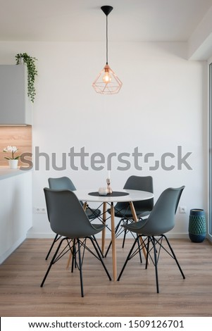 Dining table next to kitchen in contemporary house #1509126701