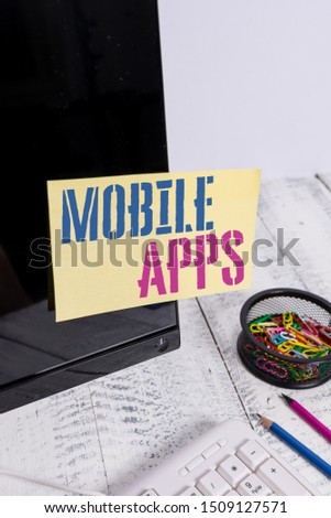 Handwriting text writing Mobile Apps. Concept meaning small programs are made to work on phones like app store or app store Note paper taped to black computer screen near keyboard and stationary. #1509127571