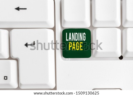 Conceptual hand writing showing Landing Page. Business photo showcasing Website accessed by clicking a link on another web page White pc keyboard with note paper above the white background. #1509130625