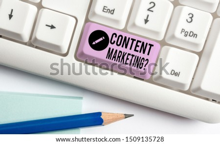 Handwriting text Content Marketing Question. Concept meaning involves creation and sharing of online material White pc keyboard with empty note paper above white background key copy space. #1509135728