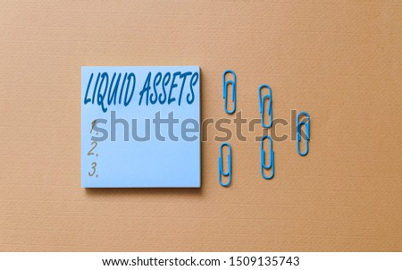 Writing note showing Liquid Assets. Business photo showcasing Cash and Bank Balances Market Liquidity Deferred Stock Colored blank sticky note clips gathered trendy cool pastel background. #1509135743