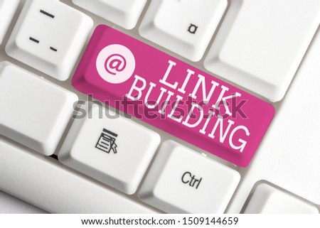 Writing note showing Link Building. Business photo showcasing SEO Term Exchange Links Acquire Hyperlinks Indexed White pc keyboard with note paper above the white background. #1509144659