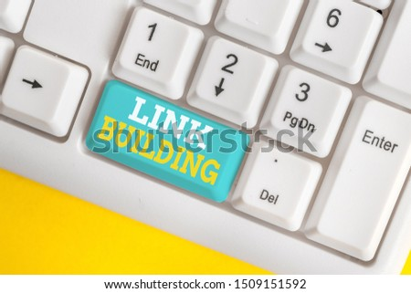 Writing note showing Link Building. Business photo showcasing SEO Term Exchange Links Acquire Hyperlinks Indexed White pc keyboard with note paper above the white background. #1509151592