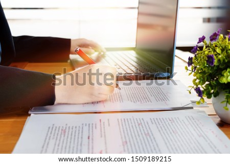 hand working on editing blur text on desk with laptop in office