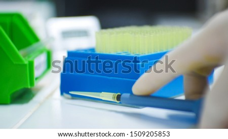 Auto pipette and pipette tip in laboratory using with scientist. #1509205853