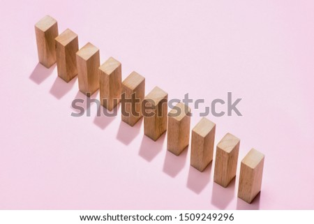 Domino block. Dominoes continuous toppled on pink background. #1509249296