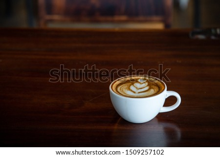 Hot art Latte Coffee in a cup on wooden table and Coffee shop blur background #1509257102