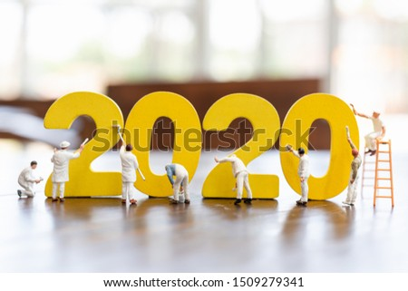 Miniature worker team painted number 2020  , Happy new year 2019 concept