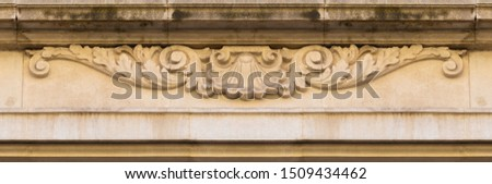 Elements of architectural decoration of buildings, stucco patterns with flowers and faces, gypsum ornaments and wall textures. On the streets in Barcelona, public places. #1509434462