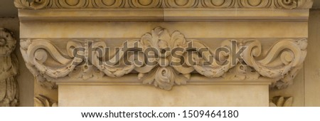 Elements of architectural decoration of buildings, stucco patterns with flowers, gypsum ornaments and wall textures. On the streets in Barcelona, public places. #1509464180