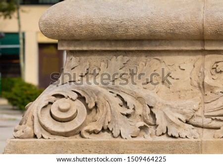 Elements of architectural decoration of buildings, stucco patterns with flowers, gypsum ornaments and wall textures. On the streets in Barcelona, public places. #1509464225