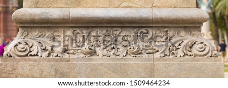 Elements of architectural decoration of buildings, stucco patterns with flowers, gypsum ornaments and wall textures. On the streets in Barcelona, public places. #1509464234