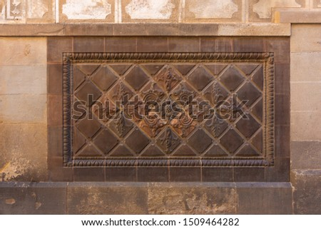Elements of architectural decoration of buildings, stucco patterns with flowers, gypsum ornaments and wall textures. On the streets in Barcelona, ​​public places. #1509464282
