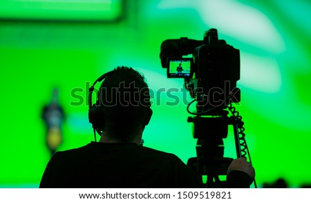 Silhouette of a Cameraman and Video Camera at live broadcast news event