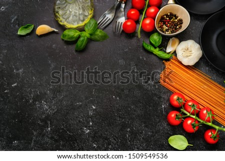 Top view on dry pasta and fresh cherry tomatoes #1509549536