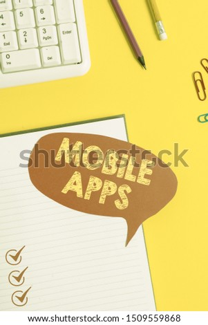 Text sign showing Mobile Apps. Conceptual photo small programs are made to work on phones like app store or app store Pink empty paper on the yellow table with pencil. #1509559868