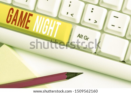 Handwriting text writing Game Night. Concept meaning event in which folks get together for the purpose of getting laid White pc keyboard with empty note paper above white background key copy space. #1509562160