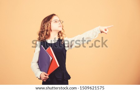 Prepare for exam. Preparing to exams in library. Small child formal wear. Formal education and homeschooling. Check knowledge. Final exam coming. Girl hold textbook folder test. School exam concept. #1509621575