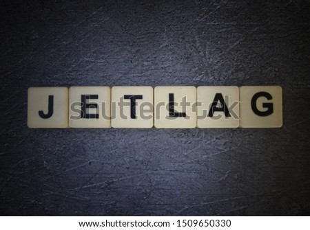 Jetlag, word cube with background #1509650330