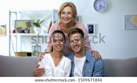 Mother-in-law embracing son and his wife, happy family relationship concept #1509671846