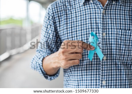 November Prostate Cancer Awareness month, Man in blue shirt with hand holding Blue Ribbon for supporting people living and illness. Healthcare, International men, Father and World cancer day concept #1509677330