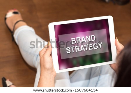 Tablet screen displaying a brand strategy concept #1509684134