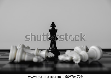 Chess King stand as last winner, victory over the enemies. The winner in business competition. Competitiveness and strategy. #1509704729