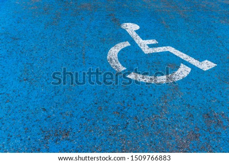 Iconic wheelchair sign painted on parking space. #1509766883