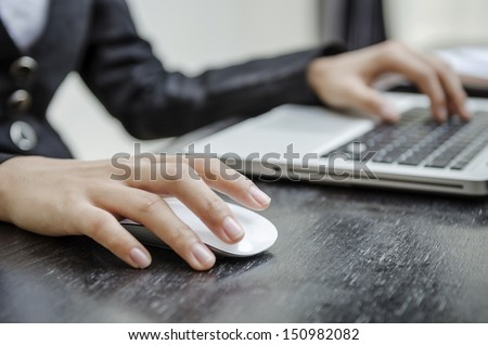Holding laptop mouse #150982082