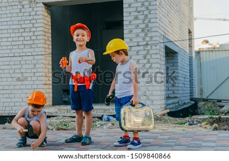 Children's role-playing games - a profession builder. Early development of the child, ideas for the game. A team of builders with tools at a construction site. Fun time with friends #1509840866
