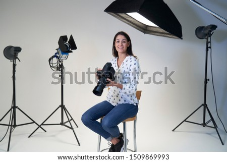 Portrait Of Female Photographer In Studio For Photo Shoot With Camera And Lighting Equipment     #1509869993