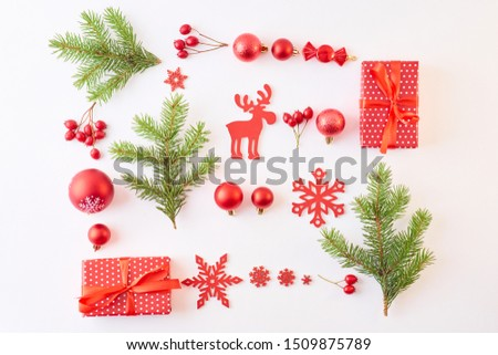 Flat lay christmas pattern with evergreen tree branch, balls and gift box on a white background #1509875789