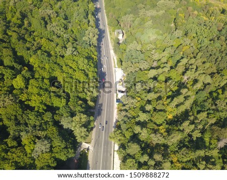 Aerial view. The road through the green forest. #1509888272