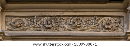 Elements of architectural decoration of buildings, stucco patterns with flowers, gypsum ornaments and wall textures. On the streets in Barcelona, public places. #1509988871
