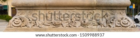 Elements of architectural decoration of buildings, stucco patterns with flowers, gypsum ornaments and wall textures. On the streets in Barcelona, public places. #1509988937