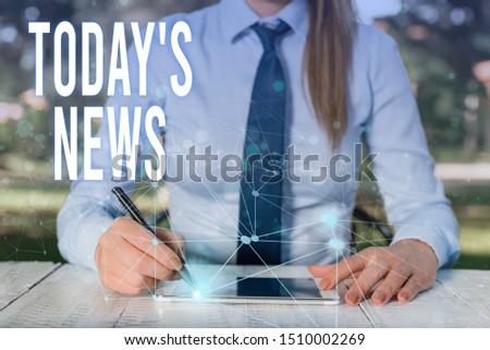 Conceptual hand writing showing Today S News. Business photo showcasing Latest Breaking Headlines Current Updates Trending Female human wear formal work suit presenting smart device. #1510002269