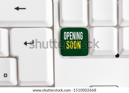 Conceptual hand writing showing Opening Soon. Business photo showcasing Going to be available or accessible in public anytime shortly White pc keyboard with note paper above the white background. #1510002668